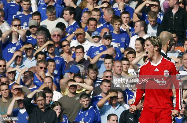 Liverpool's Spanish forward Fernando Torres celebrates after scoring his second goal against Everton during their English Premier League football...