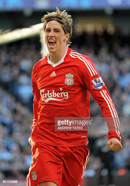 Liverpool's Spanish forward Fernando Torres celebrates after scoring his second goal during the English Premier league football match against...