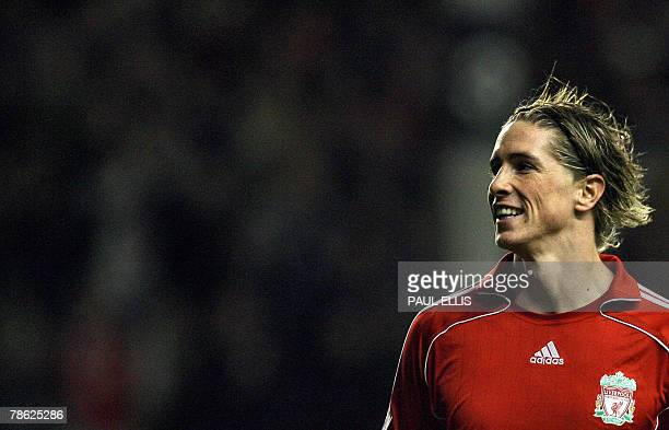 Liverpool's Spanish forward Fernando Torres celebrates scoring against Portsmouth during their English Premiership football match 22 December 2007 at...