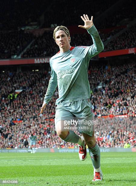 Liverpool's Spanish forward Fernando Torres celebrates scoring the equalising goal against Manchester United during their English Premier League...