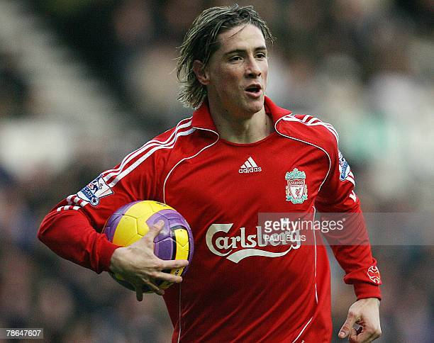Liverpool's Spanish forward Fernando Torres collects the ball after scoring the opening goal against Derby County during their English Premiership...
