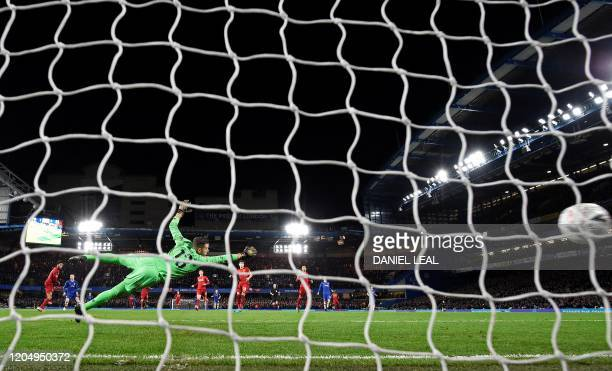 TOPSHOT Liverpool's Spanish goalkeeper Adrian dives but fails to save Chelsea's English midfielder Ross Barkley's goal during the English FA Cup...