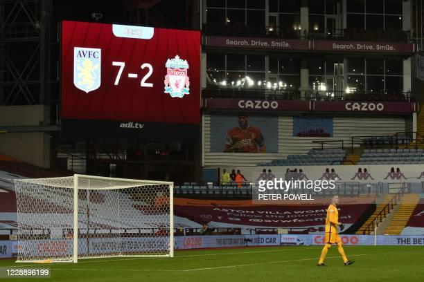 Liverpool's Spanish goalkeeper Adrian in his goal area under the scoreboard displaying the 7-2 scoreline during the English Premier League football...