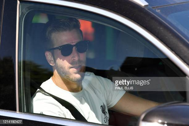 Liverpool's Spanish goalkeeper Adrian leaves from Melwood in Liverpool north west England after resuming training on May 20 as training resumes after...