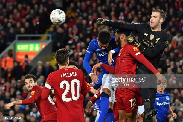 TOPSHOT Liverpool's Spanish goalkeeper Adrian punches the ball clear during the English FA Cup third round football match between Liverpool and...
