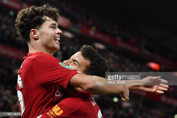 Liverpool's Spanish midfielder Pedro Chirivella congtratulates Liverpool's Welsh midfileder Neco Williams for crossing th ball to let Liverpool's...
