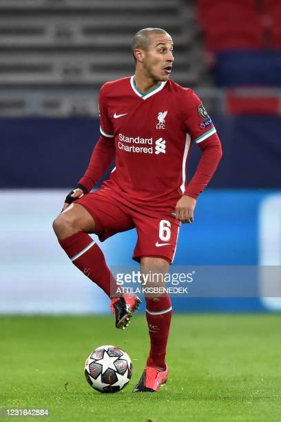 Liverpool's Spanish midfielder Thiago Alcantara controls the ball during the UEFA Champions league Last 16 2nd Leg football match between Liverpool...