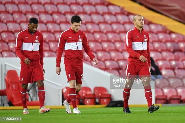 Liverpool's Spanish midfielder Thiago Alcantara , Liverpool's Scottish defender Andrew Robertson and Liverpool's Dutch midfielder Georginio Wijnaldum...
