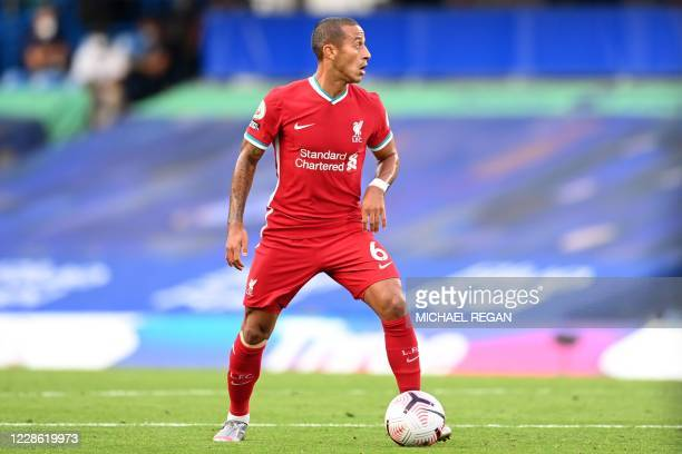Liverpool's Spanish midfielder Thiago Alcantara looks to play a pass during the English Premier League football match between Chelsea and Liverpool...