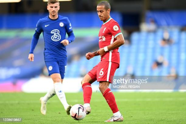 Liverpool's Spanish midfielder Thiago Alcantara passes the ball during the English Premier League football match between Chelsea and Liverpool at...