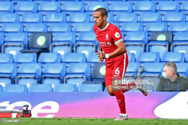 Liverpool's Spanish midfielder Thiago Alcantara runs onto the pitch during the English Premier League football match between Chelsea and Liverpool at...