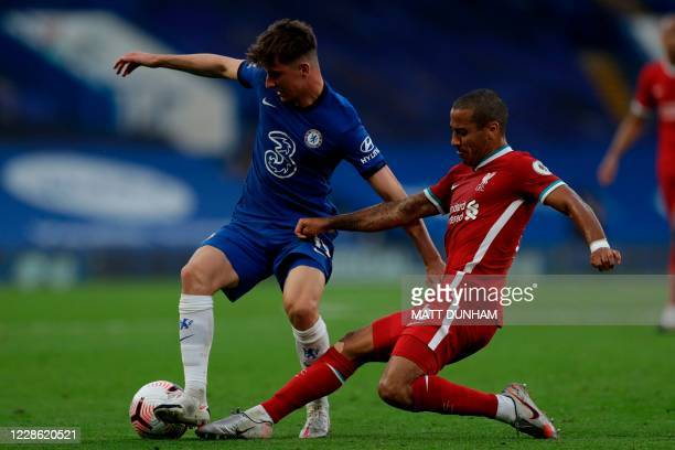 Liverpool's Spanish midfielder Thiago Alcantara tackles Chelsea's English midfielder Mason Mount during the English Premier League football match...