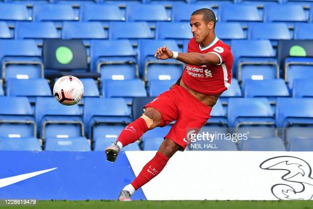 Liverpool's Spanish midfielder Thiago Alcantara warms up at half-time in the English Premier League football match between Chelsea and Liverpool at...