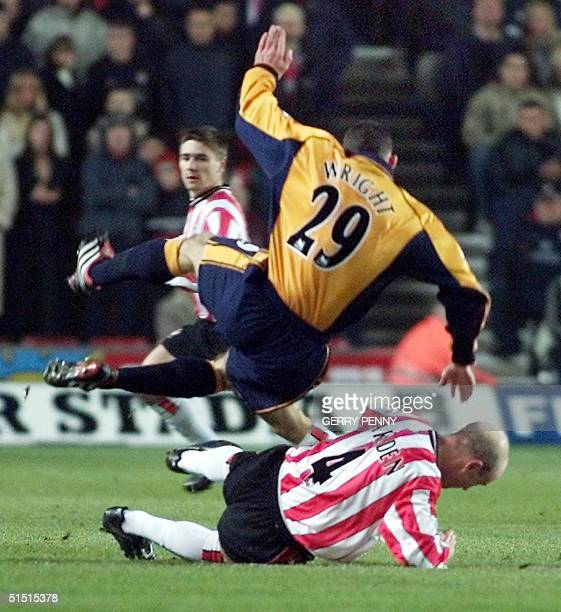 Liverpool's Stephen Wright is sent flying by Southampton defender Chris Marsden 09 January 2002 during their Premiership soccer match at St Mary's...