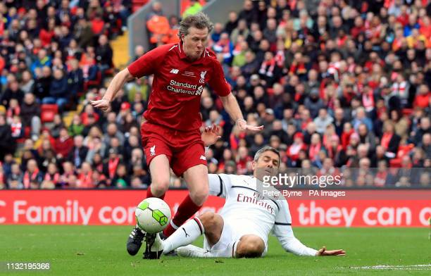 Liverpool's Steve McManaman and Milan's Alessandro Costacurta battle for the ball during the Legends match at Anfield Stadium Liverpool