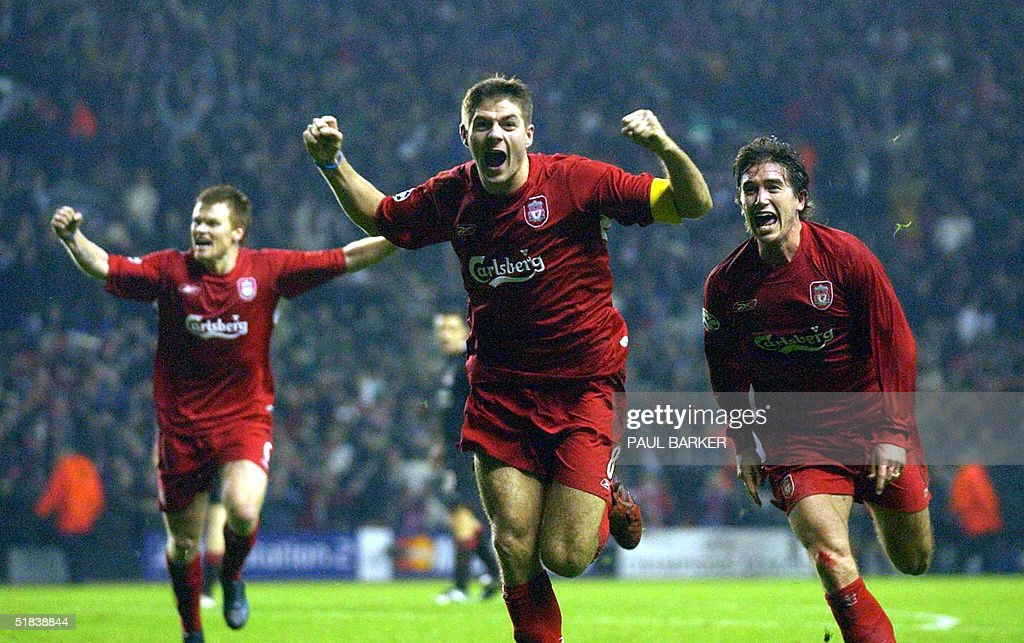 Liverpool's Steven Gerard (c) flanked by John Arne Riise (l) and Harry Kew ll (r) celebrates scoring to make it 3-1 against Olympiakos CFP during their UEFA Champions League clash at Anfield, Liverpool08 December 2004. AFP photo Paul Barker