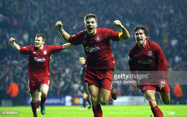 Liverpool's Steven Gerard flanked by John Arne Riise and Harry Kew ll celebrates scoring to make it 3-1 against Olympiakos CFP during their UEFA...
