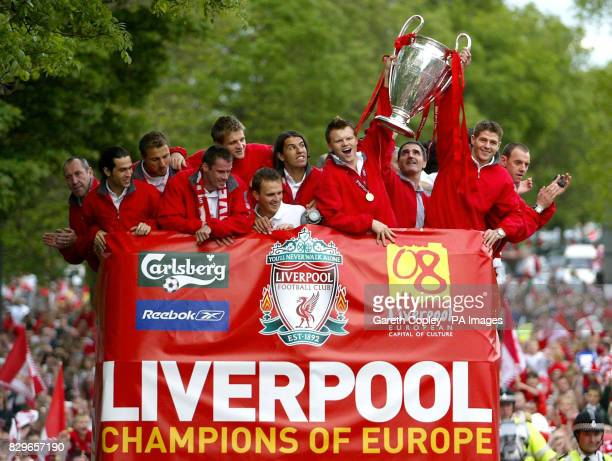 Liverpool's Steven Gerrard and John Arne Riise hold aloft the Champions League trophy as teammates celebrate from the opentop bus during the victory...