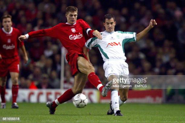Liverpool's Steven Gerrard and Olimpija Ljubljana's Branko Ilic battle for the ball