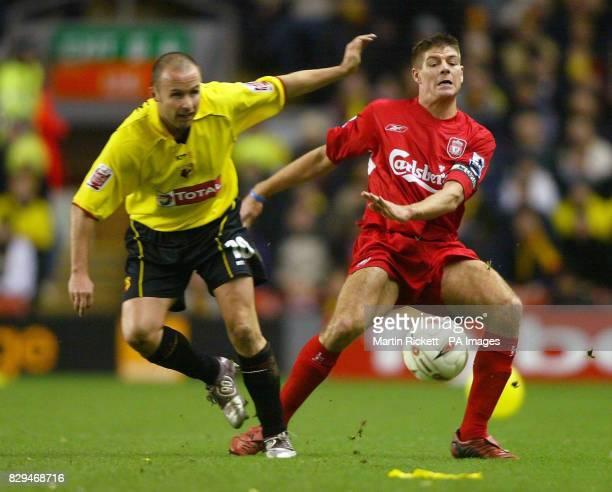 Liverpool's Steven Gerrard battles with Watford's Paul Devlin