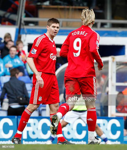 Liverpool's Steven Gerrard gestures at Liverpool's Spanish player Fernando Torres after he was substituted against Birmingham City during a Premier...