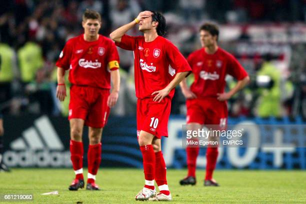 Liverpool's Steven Gerrard Luis Garcia and Xabi Alonso stand dejected after conceding a goal in the first minute of play
