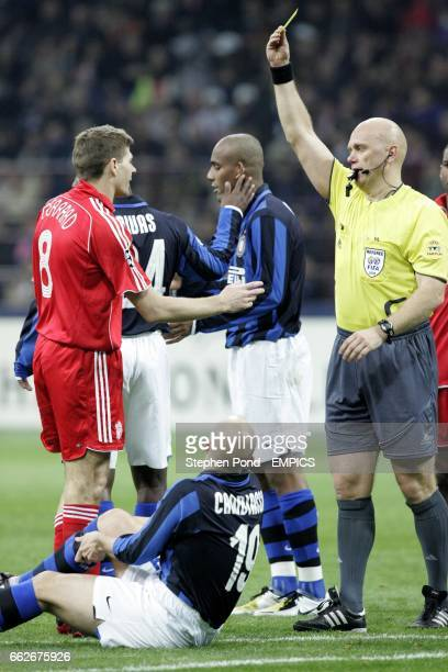Liverpool's Steven Gerrard receives a yellow card from referee Tom Henning Ovrebo