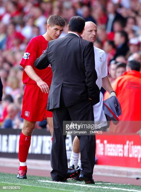 Liverpool's Steven Gerrard with manager Rafael Benitez after being replaced by Luis Garcia