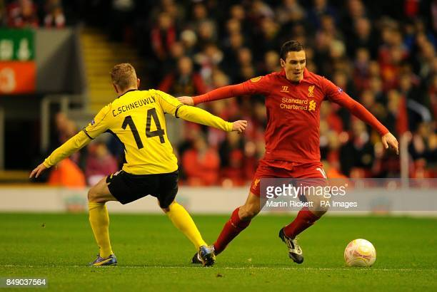 Liverpool's Stewart Downing and Young Boys' Christian Schneuwly battle for the ball