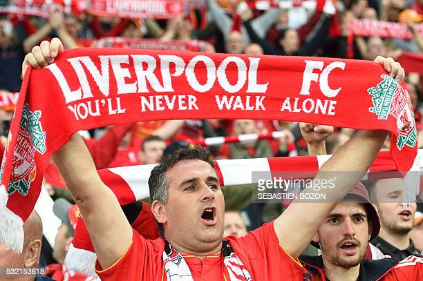 A Liverpool's supporter holds a scarf reading 'Liverpool FC you'll never walk alone' prior to the UEFA Europa League final football match between...