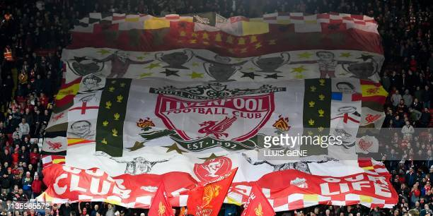 Liverpool's supporters wave a giant flag as they cheer for their team prior to the UEFA Champions League quarter-final, first leg football match...