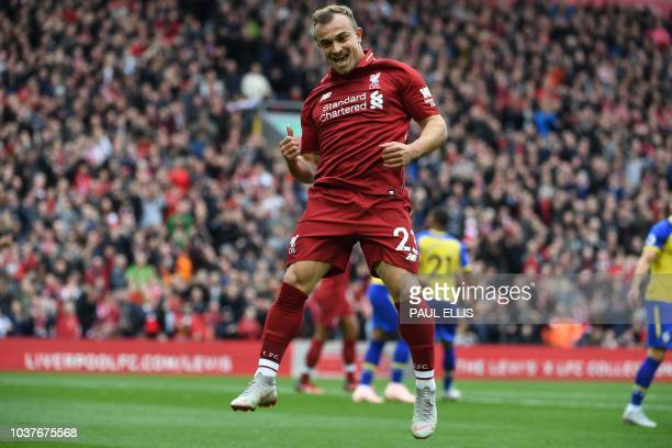 Liverpool's Swiss midfielder Xherdan Shaqiri celebrates as Southampton's Dutch defender Wesley Hoedt scores an own goal during the English Premier...