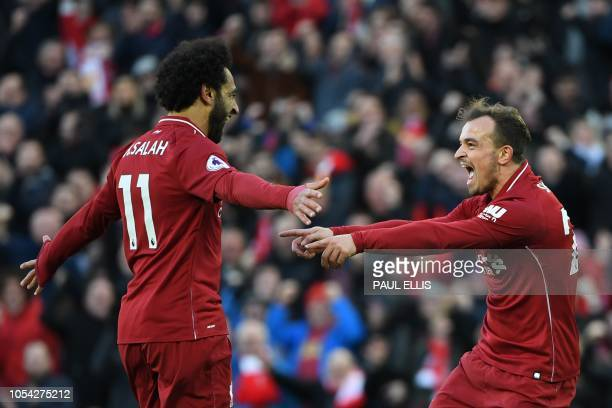 Liverpool's Swiss midfielder Xherdan Shaqiri celebrates scoring their third goal with Liverpool's Egyptian midfielder Mohamed Salah during the...
