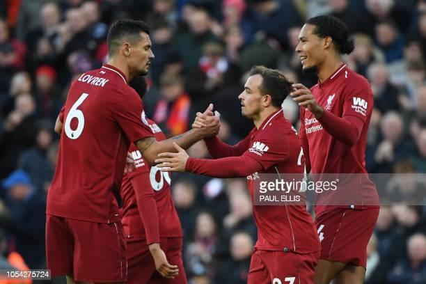 Liverpool's Swiss midfielder Xherdan Shaqiri celebrates scoring their third goal during the English Premier League football match between Liverpool...