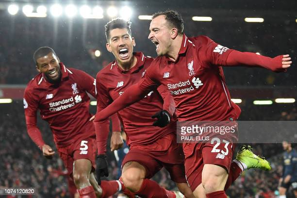 Liverpool's Swiss midfielder Xherdan Shaqiri celebrates with Liverpool's Dutch midfielder Georginio Wijnaldum and Liverpool's Brazilian midfielder...