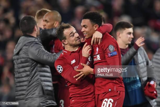 Liverpool's Swiss midfielder Xherdan Shaqiri celebrates with Liverpool's English defender Trent AlexanderArnold after winning the UEFA Champions...