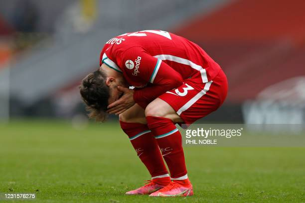Liverpool's Swiss midfielder Xherdan Shaqiri reacts after missing a chance during the English Premier League football match between Liverpool and...