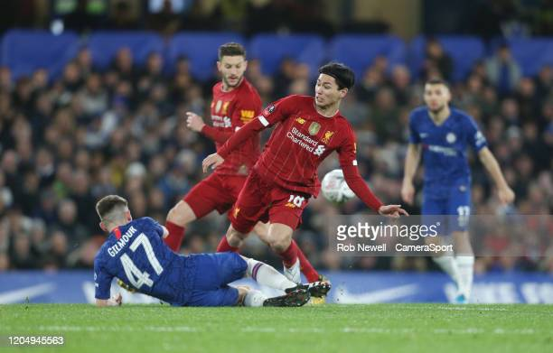 Liverpool's Takumi Minamino is challenged by Chelsea's Billy Gilmour during the FA Cup Fifth Round match between Chelsea and Liverpool at Stamford...