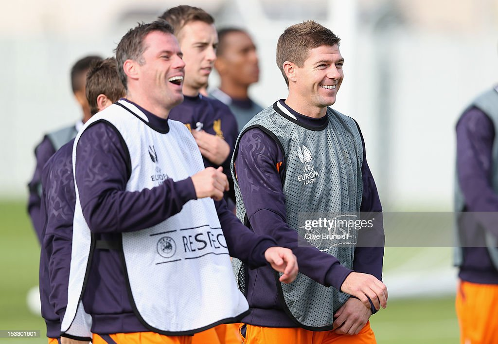 Liverpool's team captain Steven Gerrard and Jamie Carragher in good spirits during a training session ahead of their UEFA Europa League match against Udinese Calcio at Melwood Training Ground on October 3, 2012 in Liverpool, England.