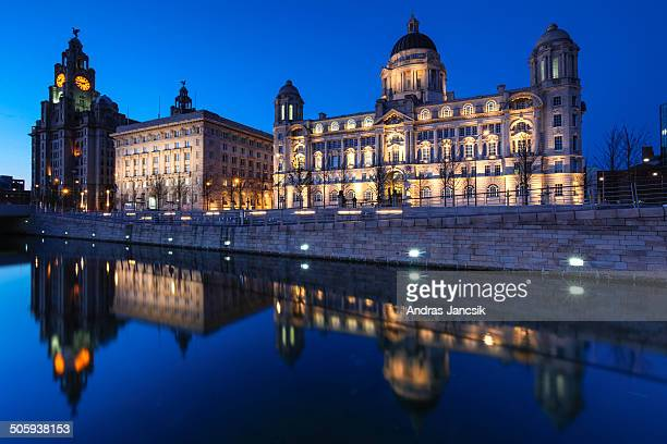Liverpool's Three Graces, the Royal Liver Building, Cunard Building and Port of Liverpool Building at the Mersey waterfront. The majestic buildings...