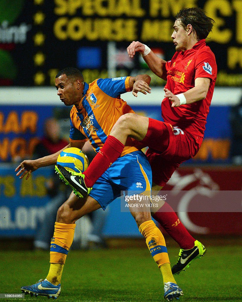 "Liverpool's Uruguayan defender Sebastian Coates (R) vies with Mansfield Town's English forward Matt Green during the FA Cup third round football match between Mansfield Town and Liverpool at Field Mill in Mansfield, central England, on January 6, 2013. USE. No use with unauthorized audio, video, data, fixture lists, club/league logos or ""live"" services. Online in-match use limited to 45 images, no video emulation. No use in betting, games or single club/league/player publications."
