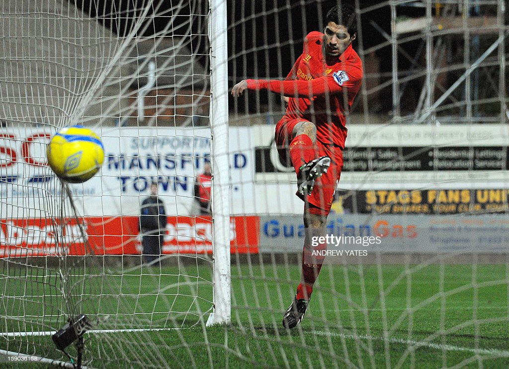 """Liverpool's Uruguayan forward Luis Suarez scores his team's second goal during the FA Cup third round football match between Mansfield Town and Liverpool at Field Mill in Mansfield, central England, on January 6, 2013. Liverpool won the match 2-1. USE. No use with unauthorized audio, video, data, fixture lists, club/league logos or """"live"""" services. Online in-match use limited to 45 images, no video emulation. No use in betting, games or single club/league/player publications."""