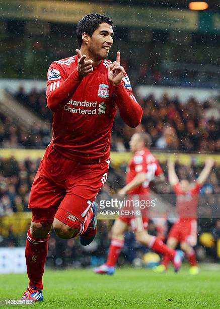 Liverpool's Uruguayan striker Luis Suarez celebrates scoring his first goal during the English Premier League football match between Norwich City and...