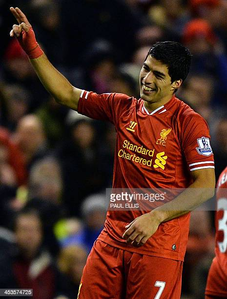Liverpool's Uruguayan striker Luis Suarez celebrates scoring his fourth goal during the English Premier League football match between Liverpool and...