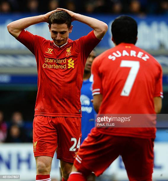 Liverpool's Uruguayan striker Luis Suarez reacts after Liverpool's Welsh midfielder Joe Allen missed an open goal during the English Premier League...