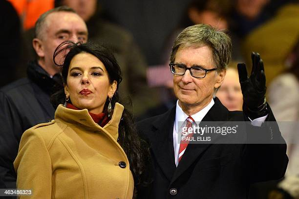Liverpool's US owner John W Henry and wife Linda Pizzuti arrive to watch the English Premier League football match between Liverpool and Aston Villa...