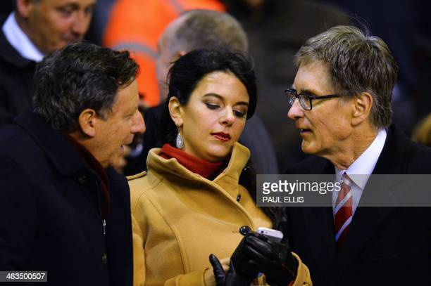 Liverpool's US owner John W Henry talks with Liverpool chairman Tom Werner as he arrives with wife Linda Pizzuti to watch the English Premier League...