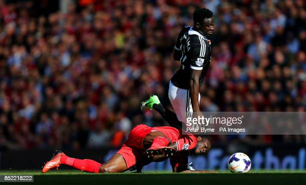 Liverpool's Victor Moses and Southampton's Victor Wanyama battle for the ball during the Barclays Premier League match at Anfield Liverpool