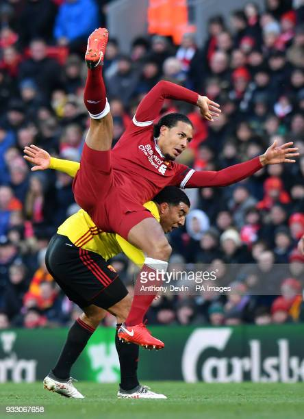 Liverpool's Virgil van Dijk and Watford's Troy Deeney battle for the ball during the Premier League match at Anfield Liverpool