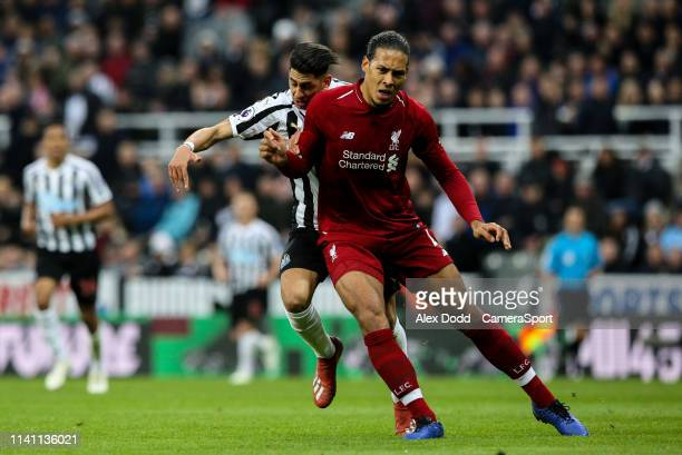 Liverpool's Virgil van Dijk appears to block the run ofNewcastle United's Ayoze Perez during the Premier League match between Newcastle United and...